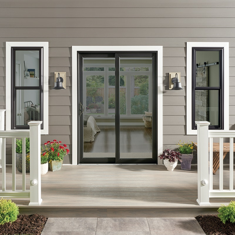 Exterior of a patio with a black finish sliding door from MI WIndows 1600 series.