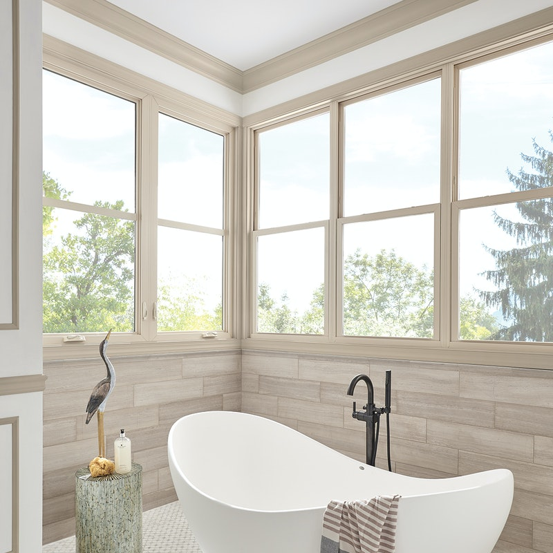 Beige bathroom with multiple single hung windows from MI 1620 series