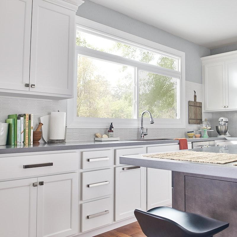 White kitchen with single slider MI window finished in white.