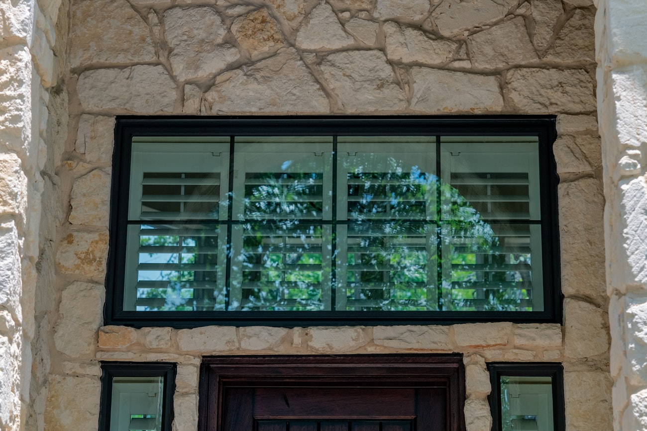Bronze transom picture window with grids