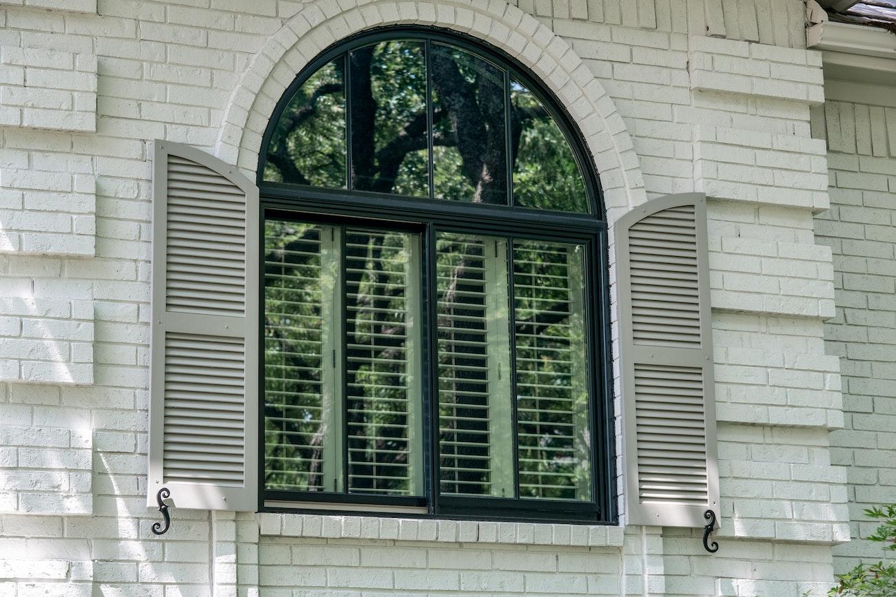 half round window over twin vertical sliders