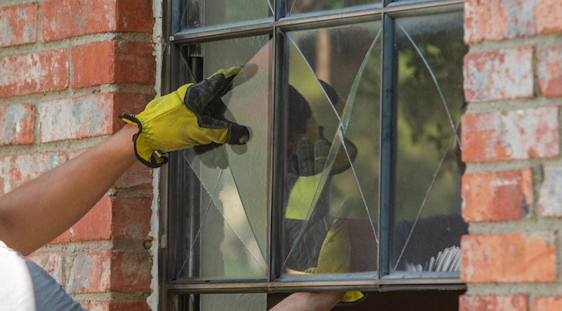 Removing glass pane from window.