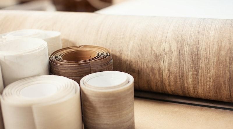 Rolls of wood veneer. Image: Adobe Stock Images