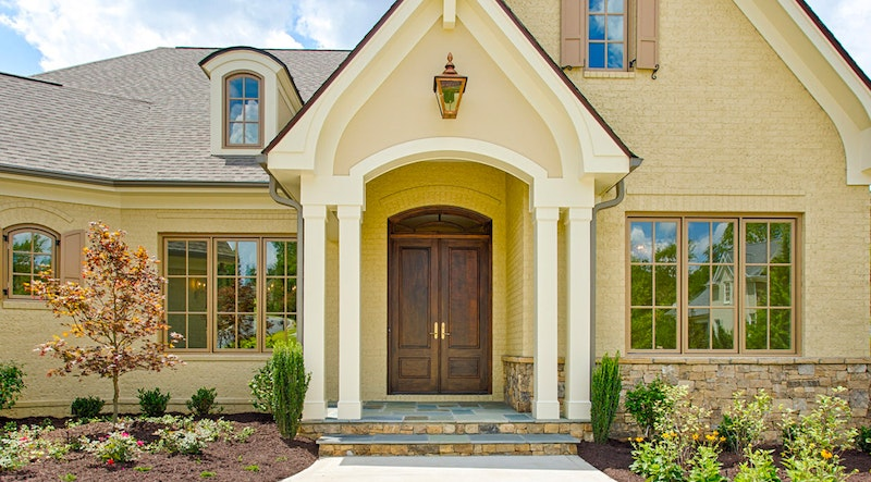 Beautiful single-family home with wood front doors.