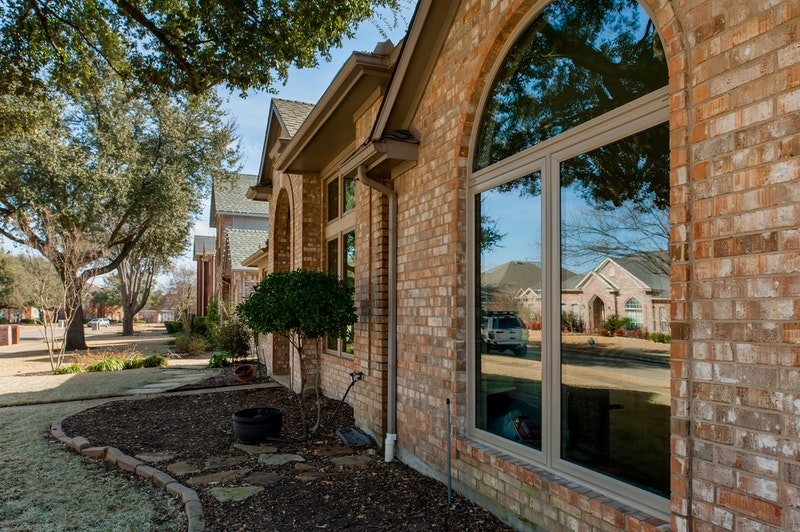 Brennan Signature windows installed on brick home - two casement windows with half round above.