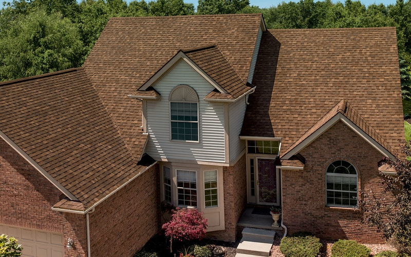 Owens Corning Oakridge roofing shingles in aged cedar.