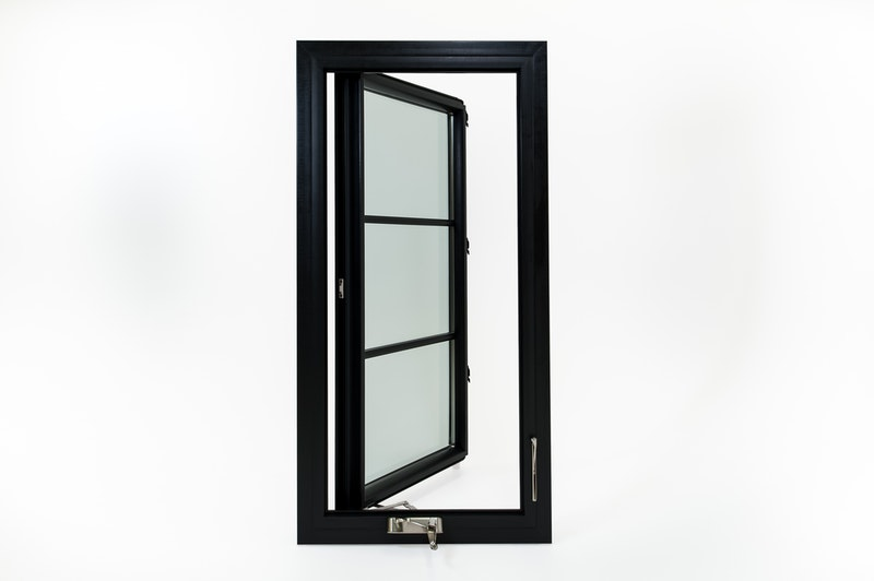 Full view of Andersen 100 series black casement windows with contemporary grids.