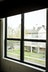 Black aluminum twin single hung windows side by side.