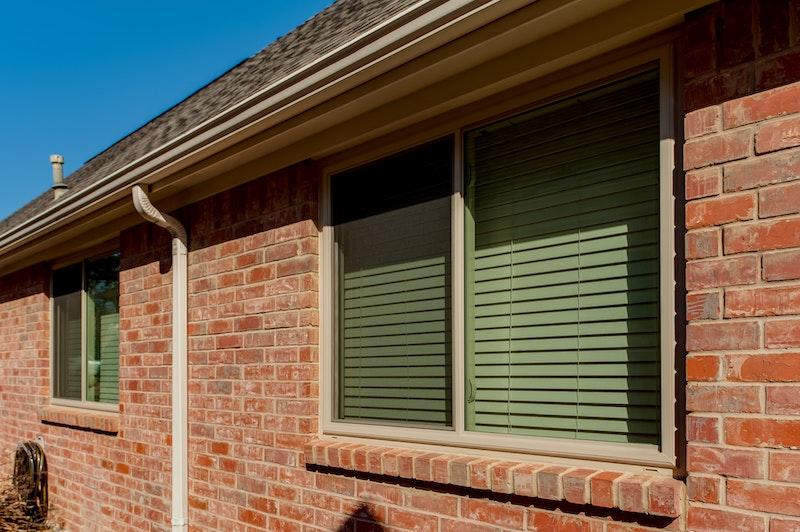 Brennan Traditions sliding windows single story brick house.