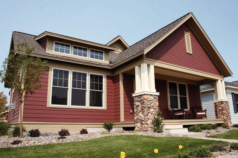 Red craftsman style house with red lap siding