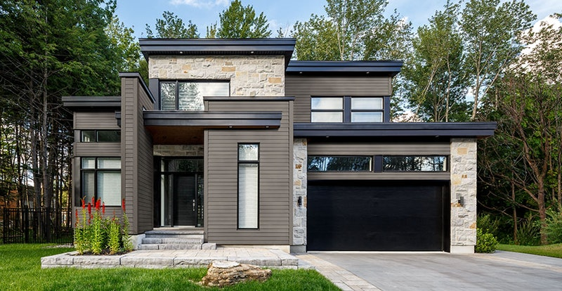 Modern house with lap siding and stone veneer.