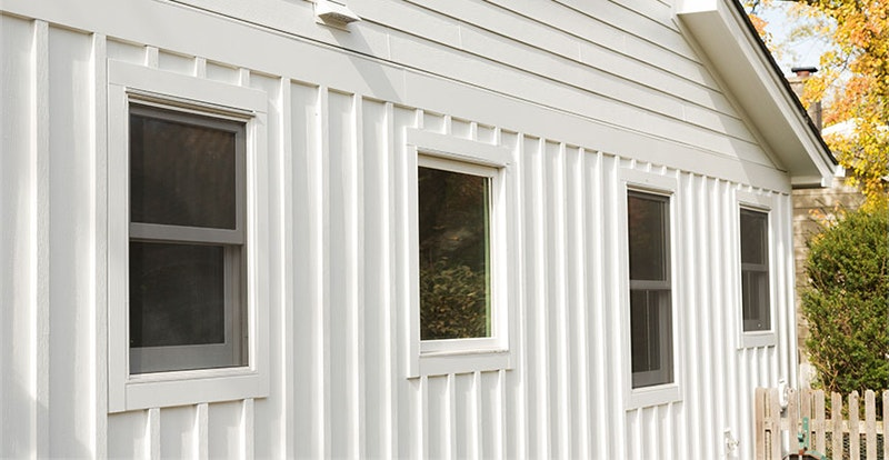 Close-up of house with board and batten panel siding.