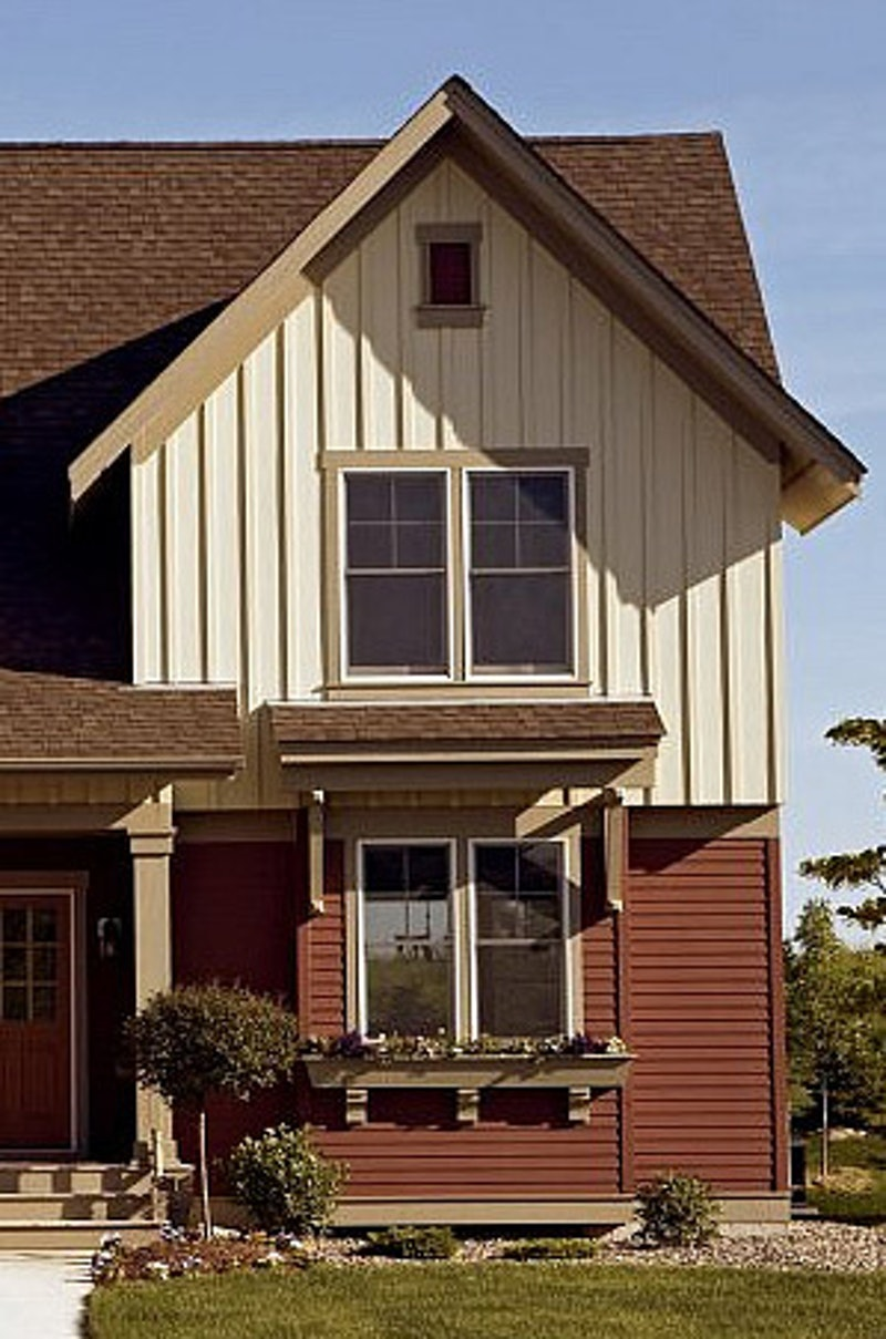 Suburban two-story house with lap siding and board and batten siding.