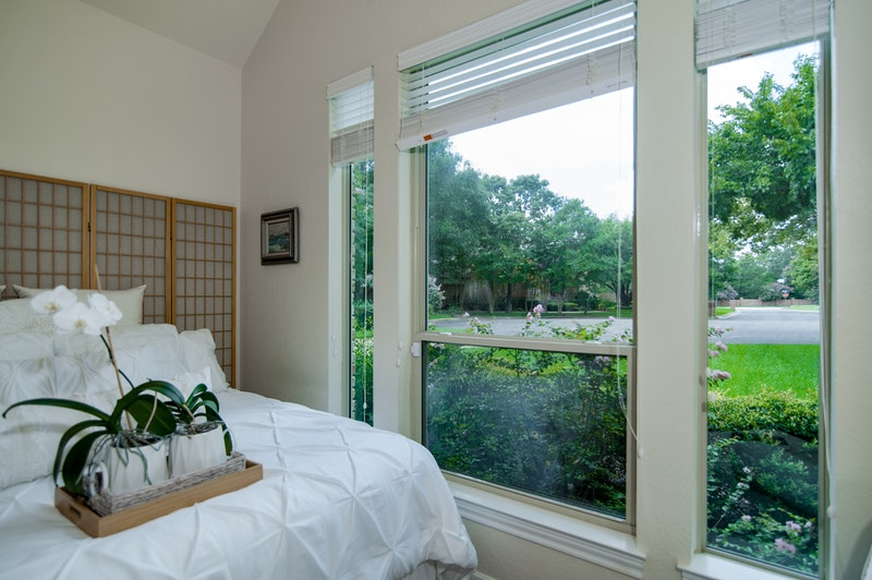 Photo of windows from interior of bedroom.