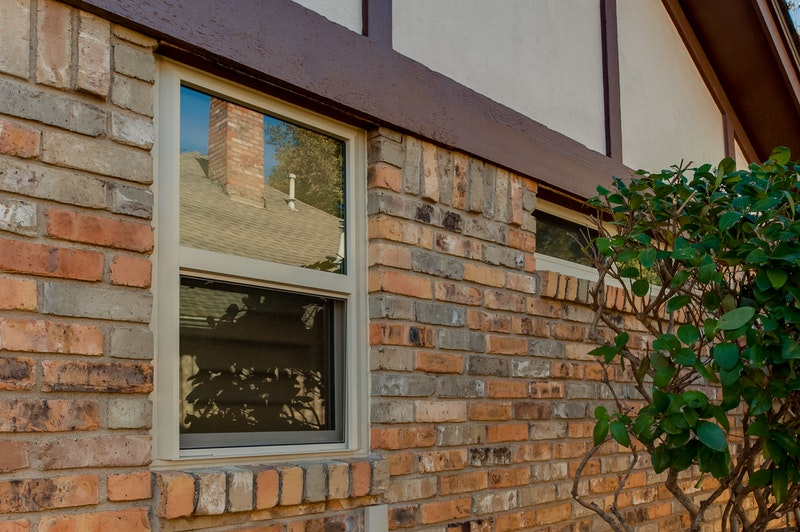 Photo of vinyl single hung window installed in brick wall.