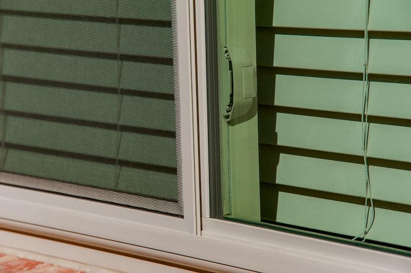 Close-up of tan sliding windows.