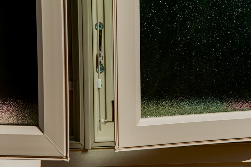 Close-up of tan open casement windows.