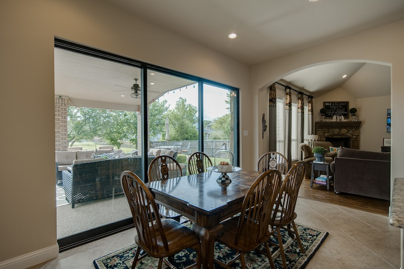 Three panel Milgard moving glass wall system in dining room.