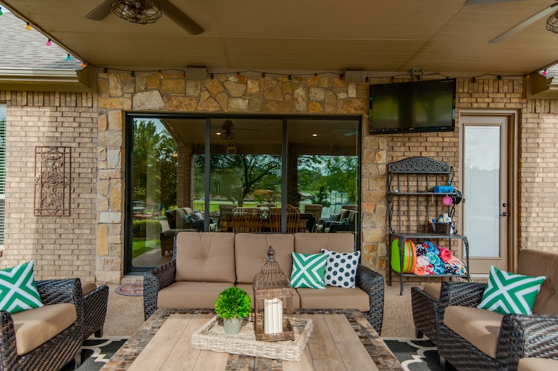 Photo of patio with furniture and Milgard moving glass wall pocket door system in the background of the photo.