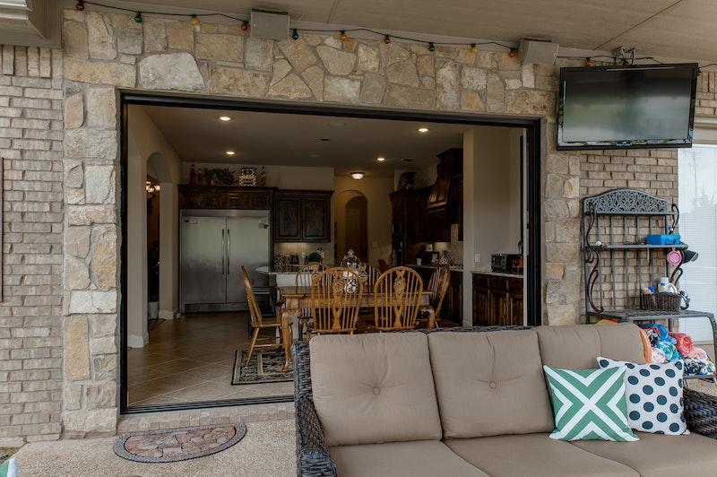 Photo of stacking pocket door open to living room.
