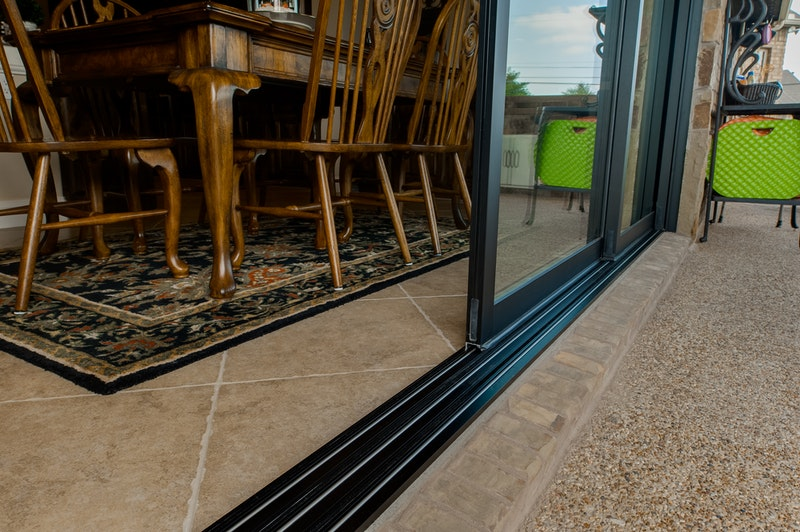 Close-up of stacking sliding pocket patio door aluminum track.