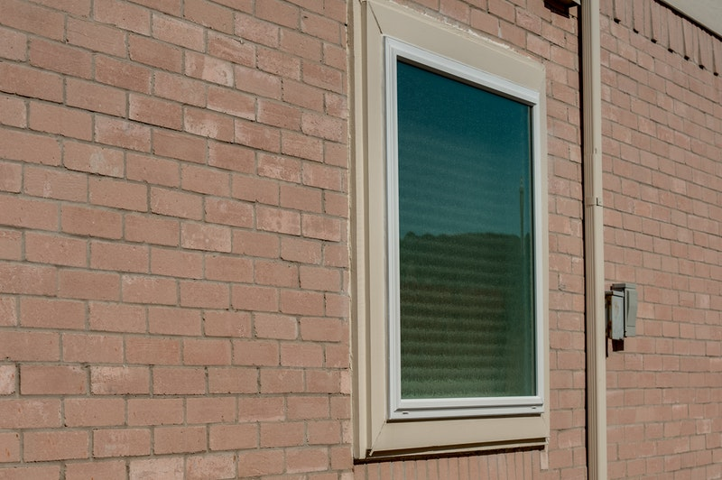 White vinyl picture window with privacy glass.