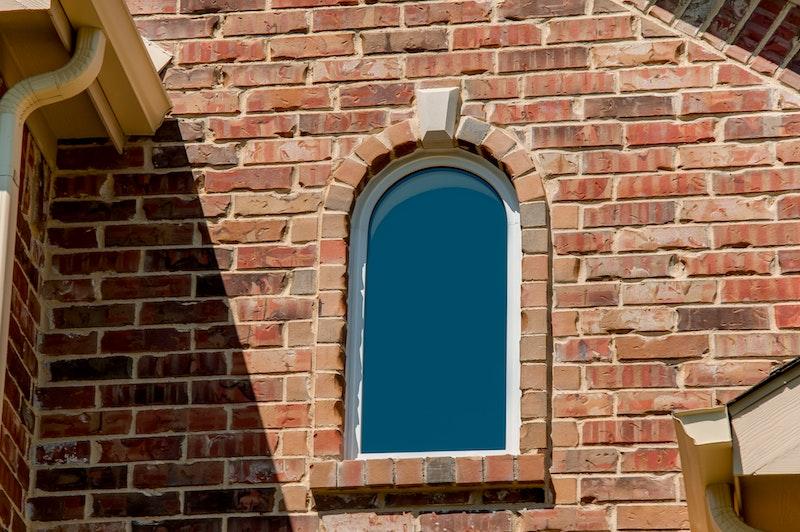 White radius installed on brick home.