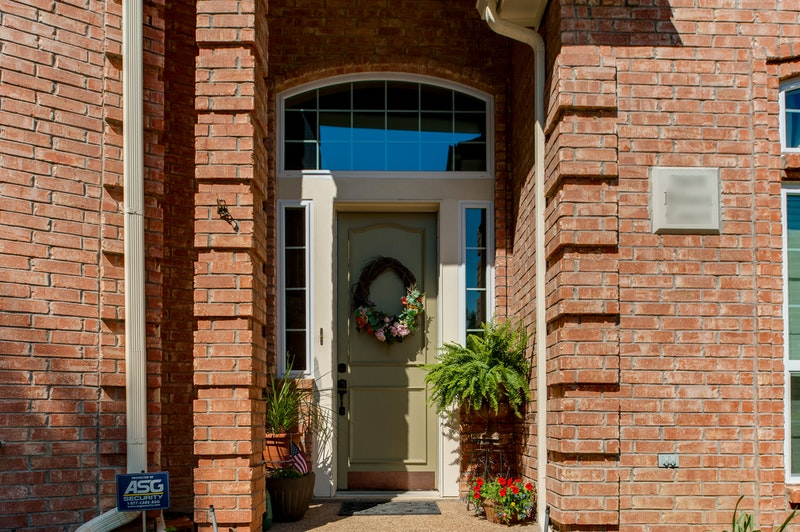 Front entry door with wreath, sidelites and transom with colonial grids.