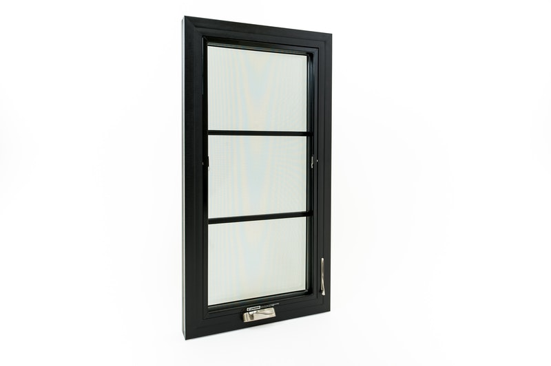 Full view of Andersen 100 Series black Fibrex casement windows with contemporary grids, interior view with crank handle hardware and lock engaged.