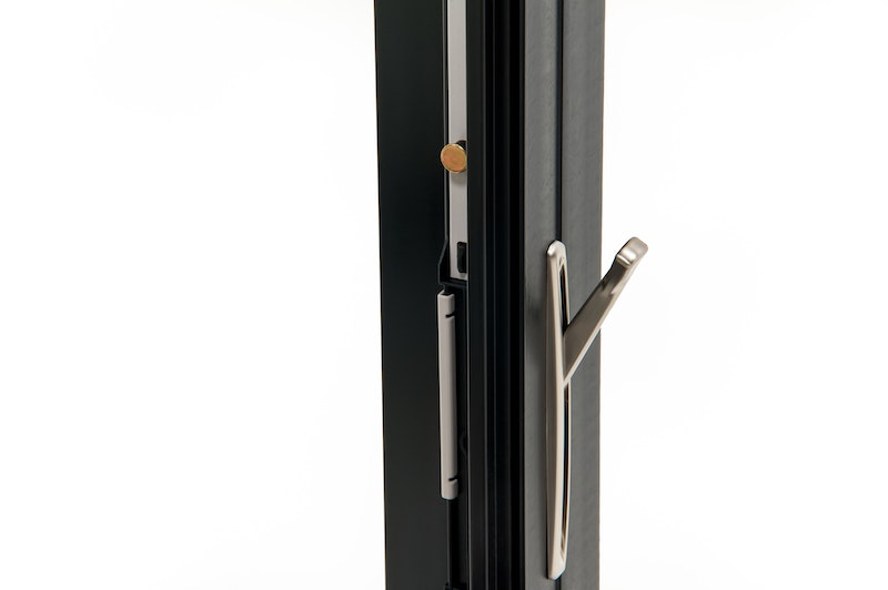 Close-up of lock on Andersen 100 series black Fibrex casement windows.