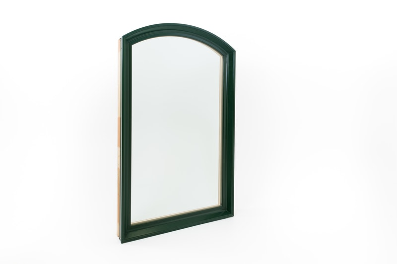 Full view photo of exterior side of Andersen 400 Series green and pine wood eyebrow picture window.