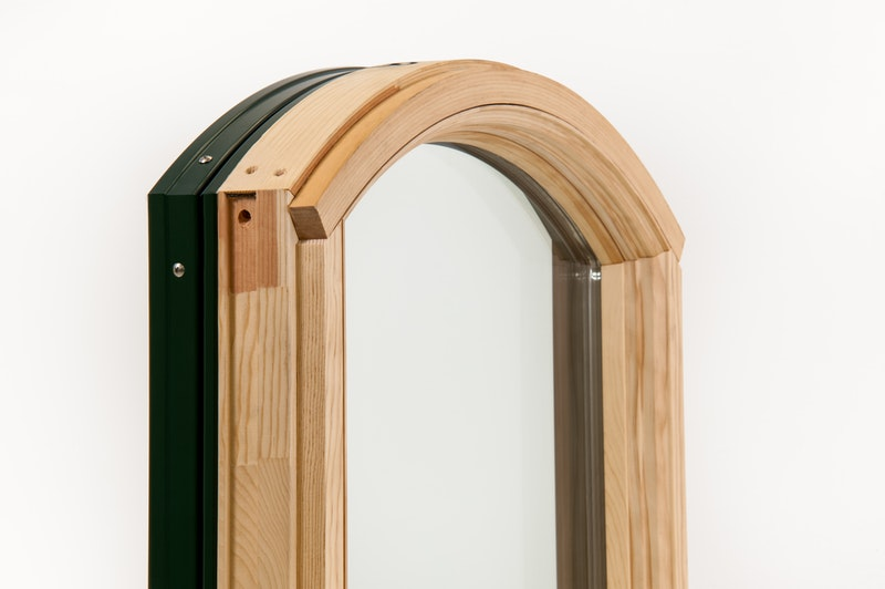 Angled interior view of Andersen 400 Series eyebrow picture window with pine wood interior, replacement window - no fins.