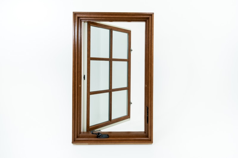 Interior view of open casement window with wood interior and bronze crank hardware.