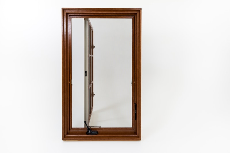 Interior view of an Andersen A-Series wood clad casement window open at a 90 degree angle.
