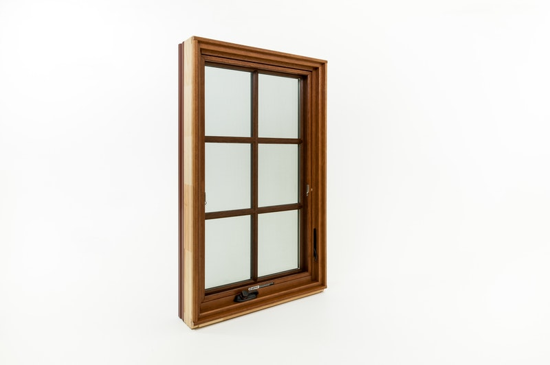 Cherry wood interior wood window with grids.