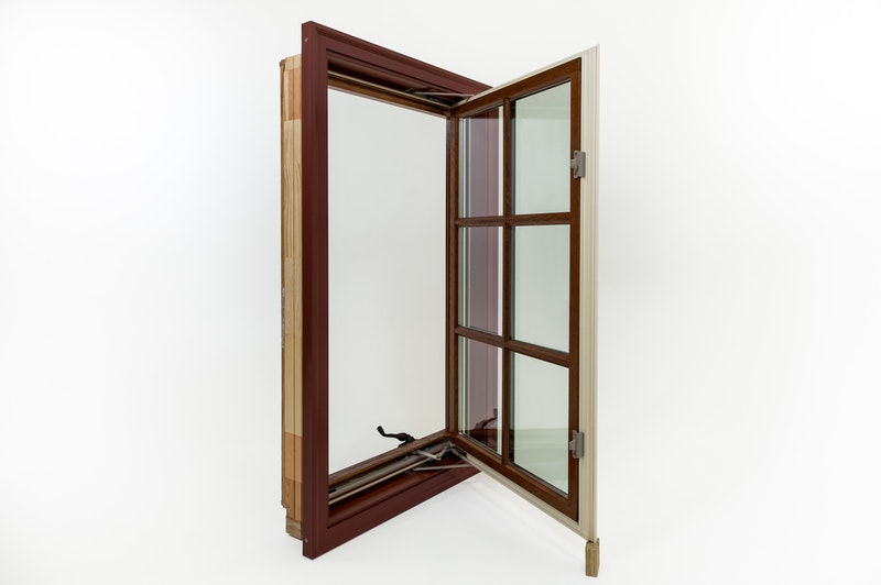 View of open cherry wood lined casement window.