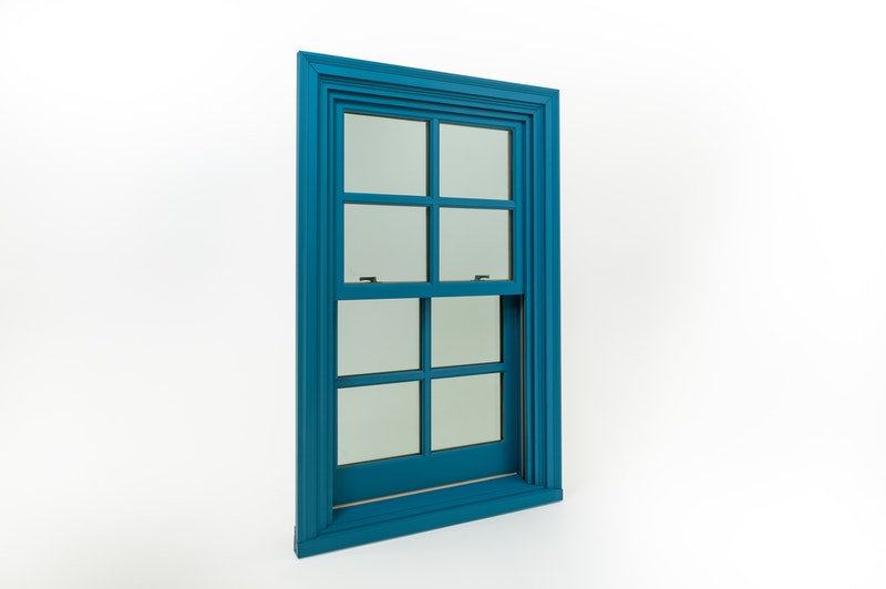Blue Andersen E-series aluminum clad double hung wood window with colonial grids.