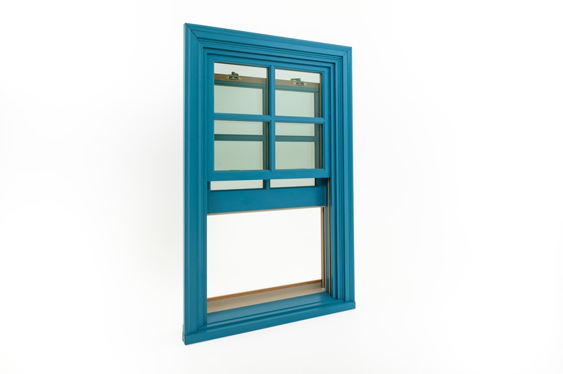 Full view of open Andersen E-series aluminum clad wood double hung wood window.