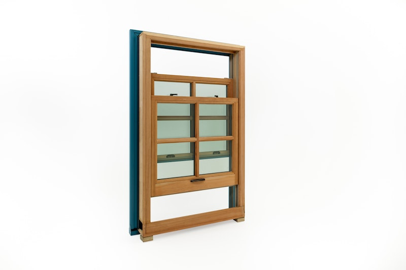 Full view of Andersen double hung window with douglas fir wood interior - both sashes have grids and are in open positions.