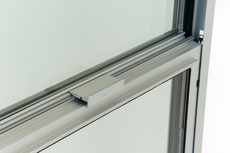 Close-up of locking hardware on metal window.