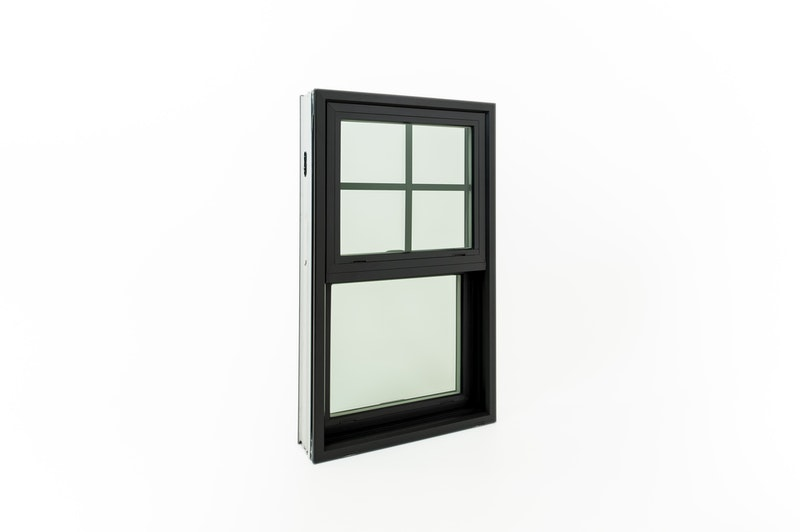 Single hung window with black finish, view from the exterior.