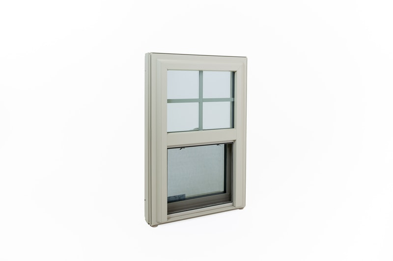 Exterior view of vinyl window with grids and half screen.