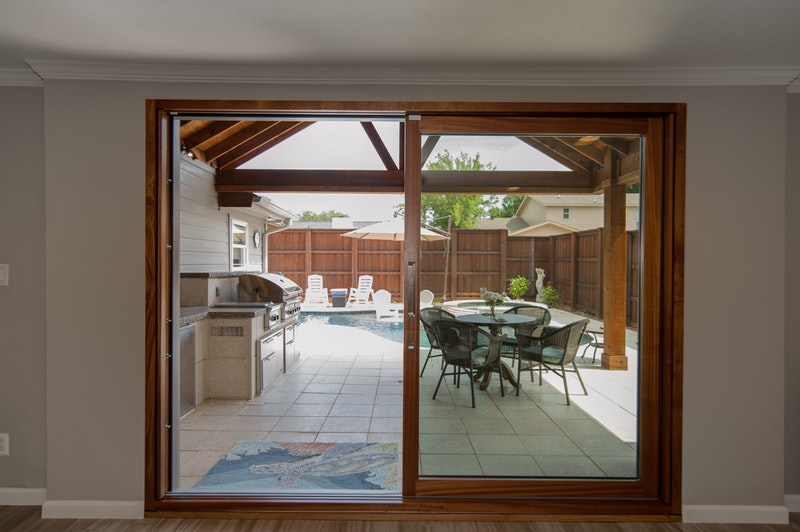 10' sliding glass patio door installed in living room facing outdoor patio and pool.