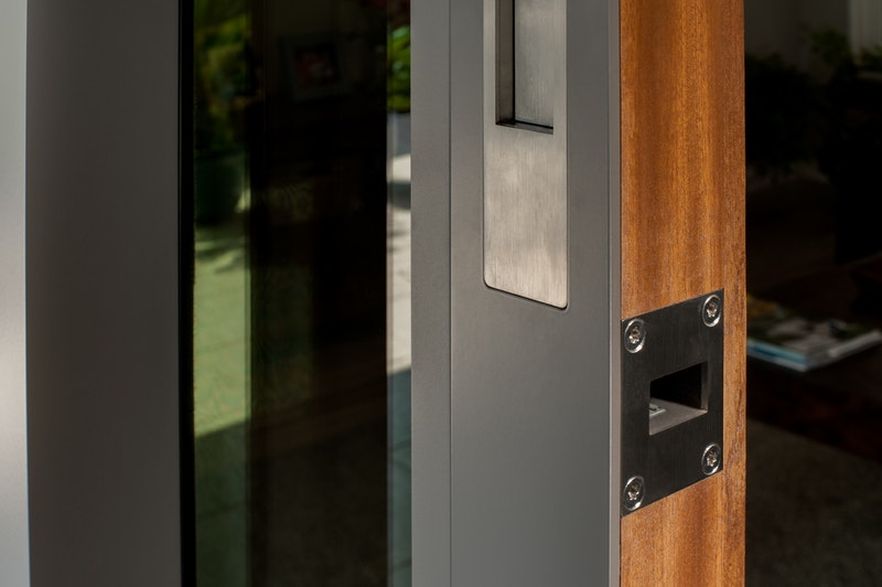 Close-up of hardware on Centor integrated sliding patio door.