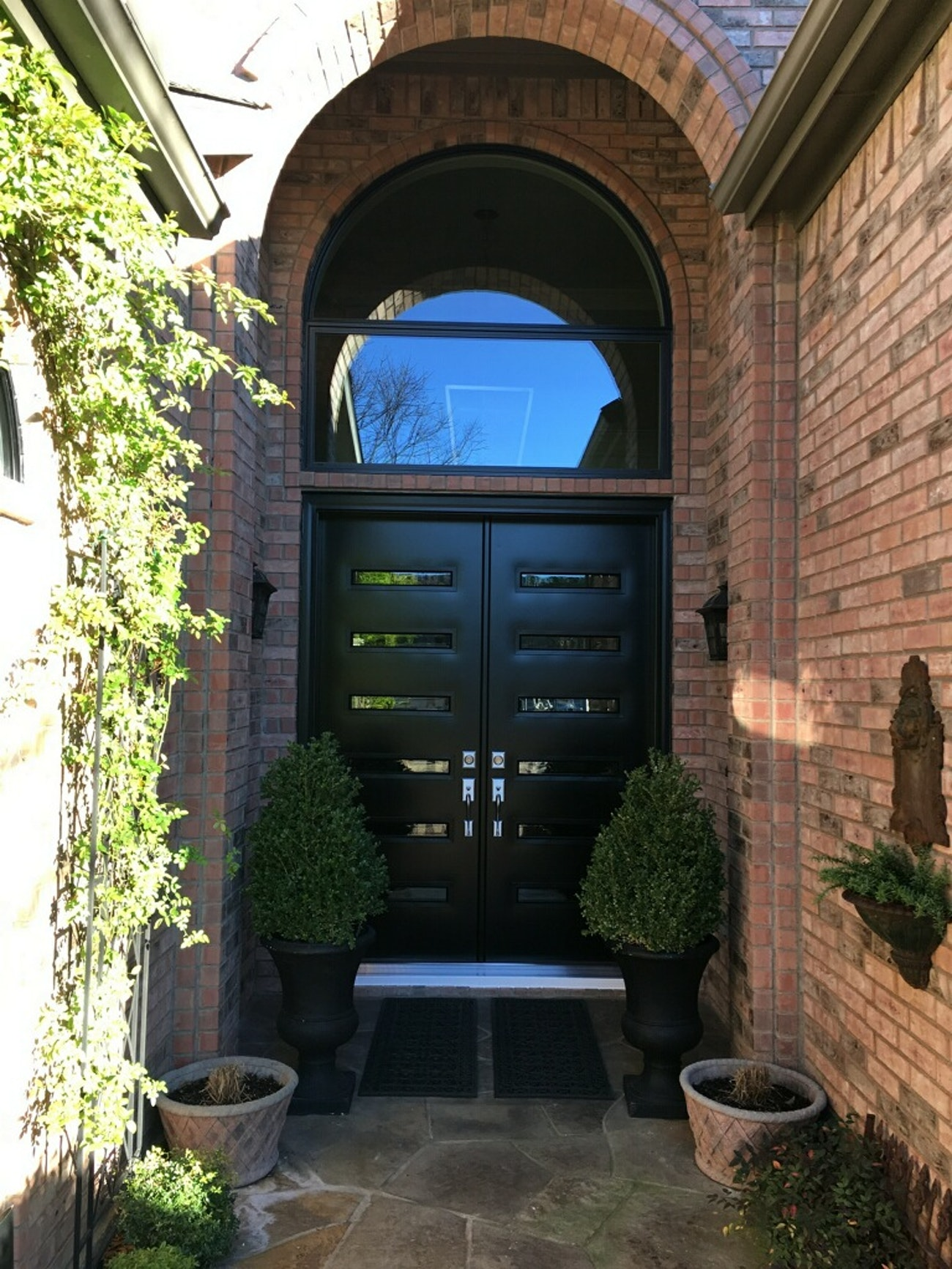black provia french doors with specialty glass with black trim