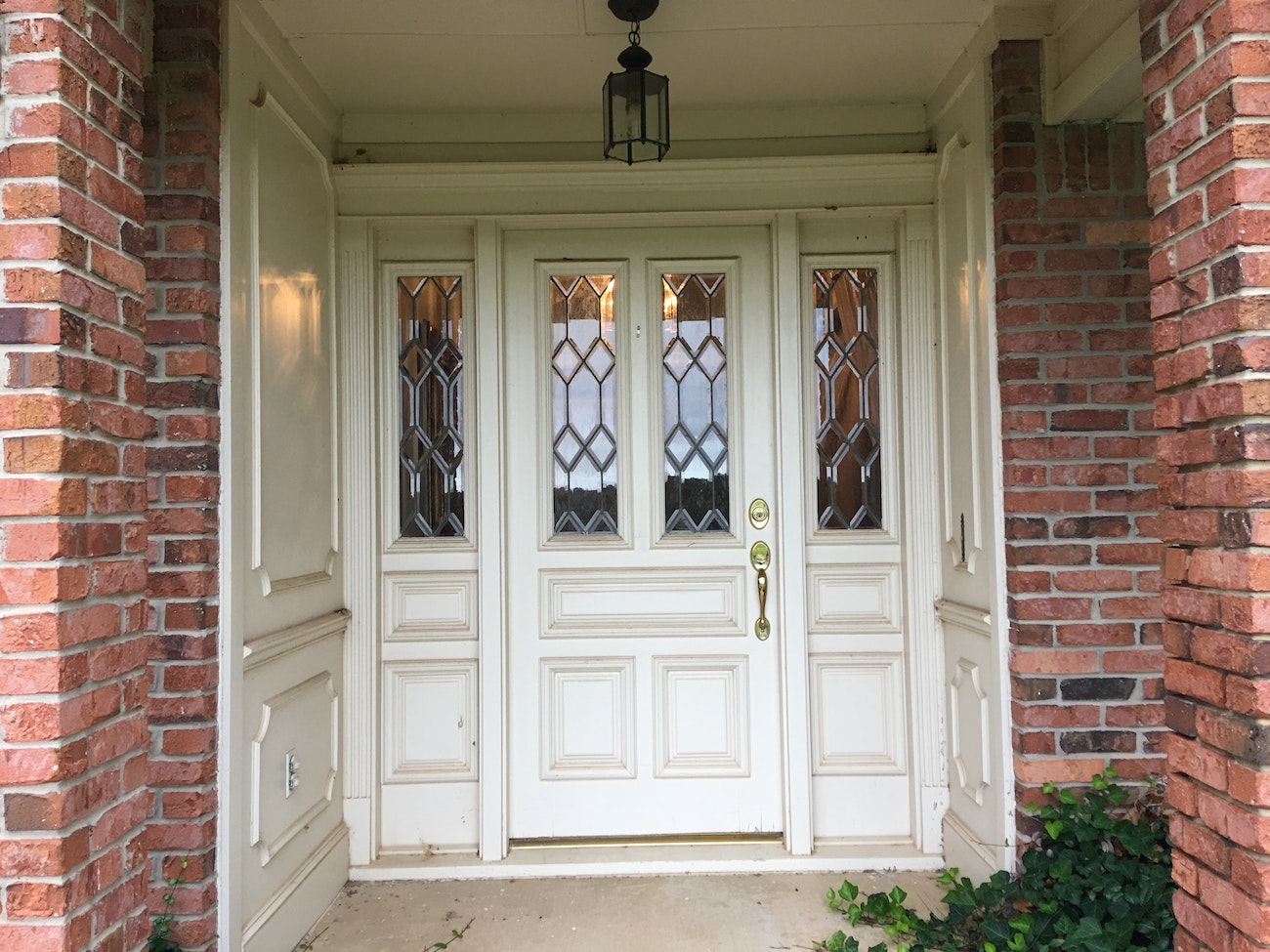 white french doors with designed glass