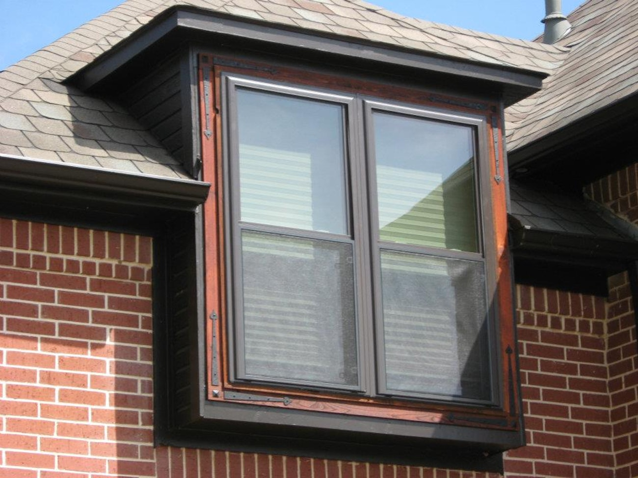 bronze-single-hung-twin-windows-with-red-brick