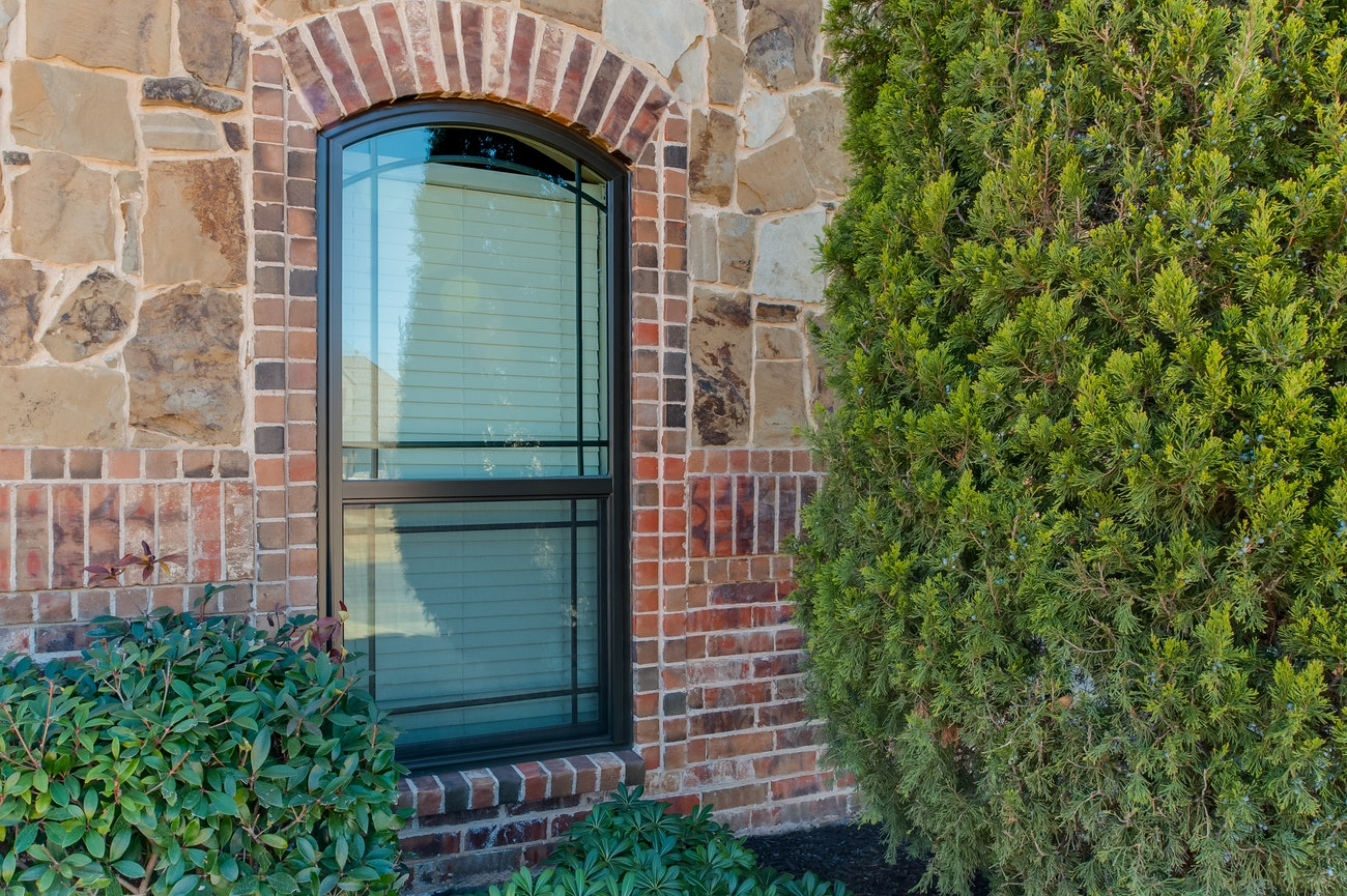 brennan-traditions-bronze-arch-top-single-hung-windows