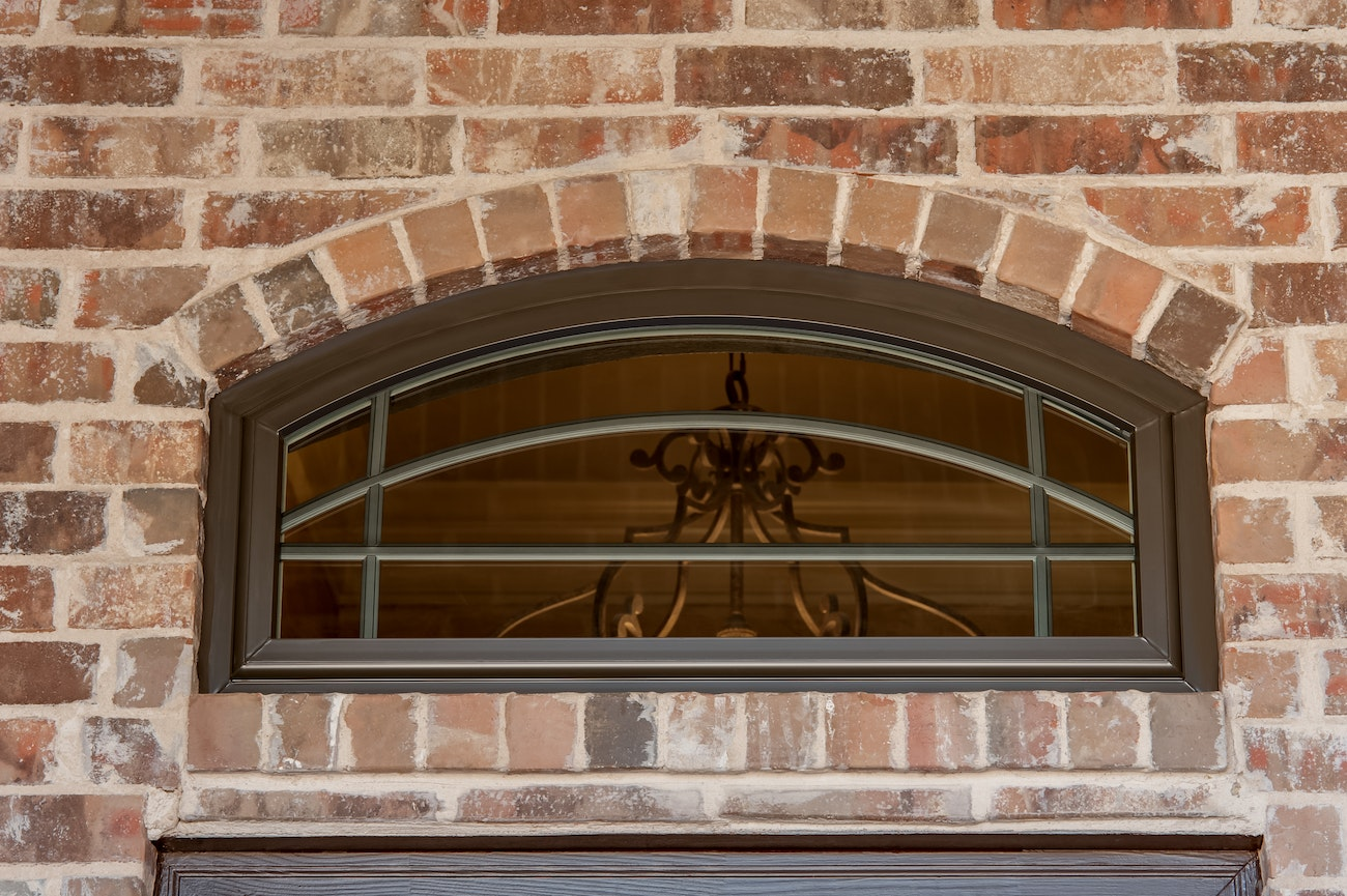 brennan-traditions-bronze-full-arch-windows-with-prairie-grids