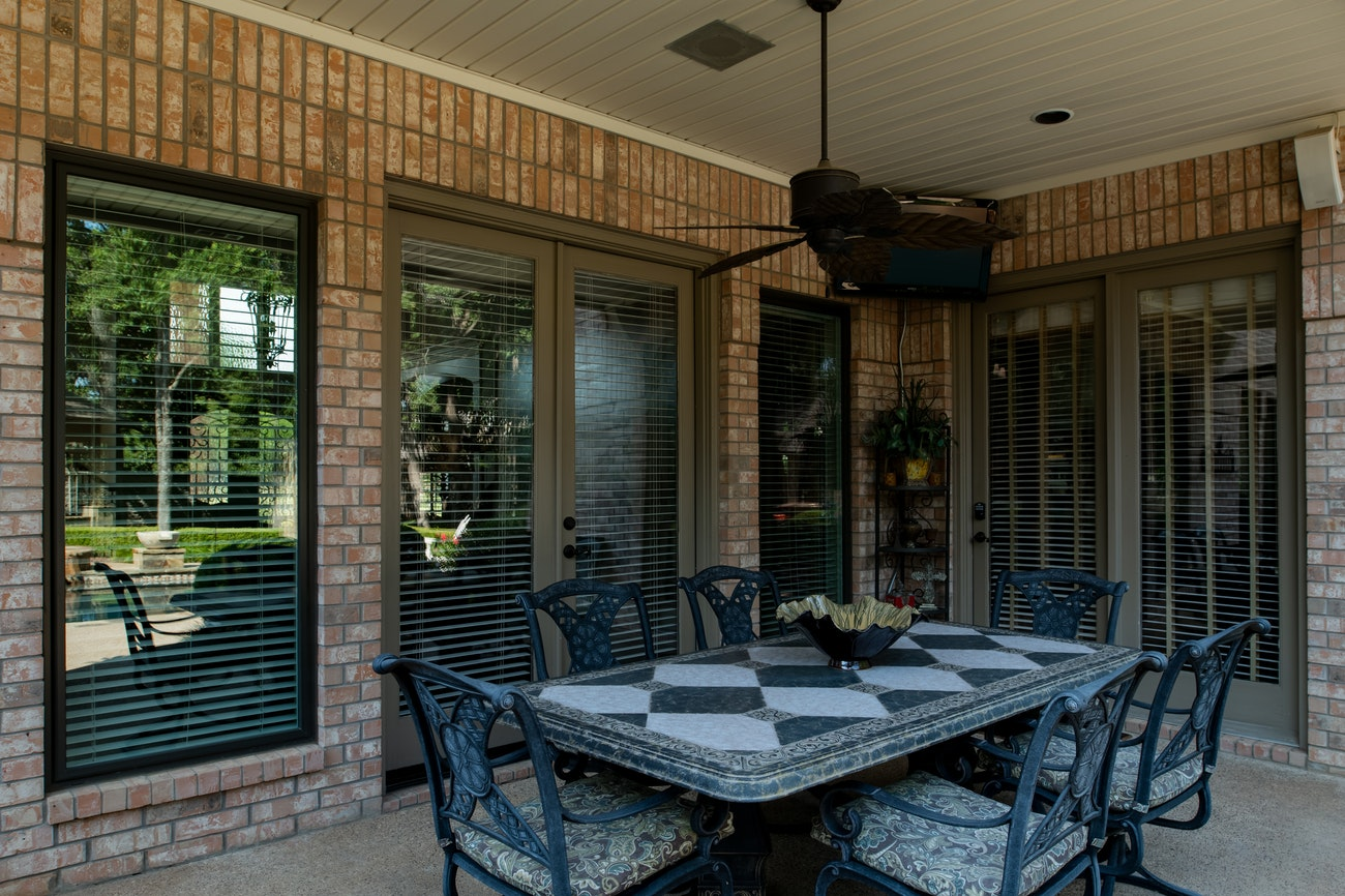 brennan-traditions-backyard-porch-with-black-trim-windows
